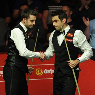 Mark Selby, left, and Ronnie O'Sullivan, right, will resume hostilities at 7pm