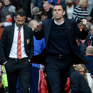 Gus Poyet, right, refuses to take anything for granted after guiding Sunderland to the brink of Barclays Premier League safety