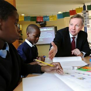 Education Secretary Michael Gove speaks to pup