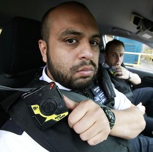 Constable Yasa Amerat and Constable Craig Pearson in their car wearing body-worn video cameras