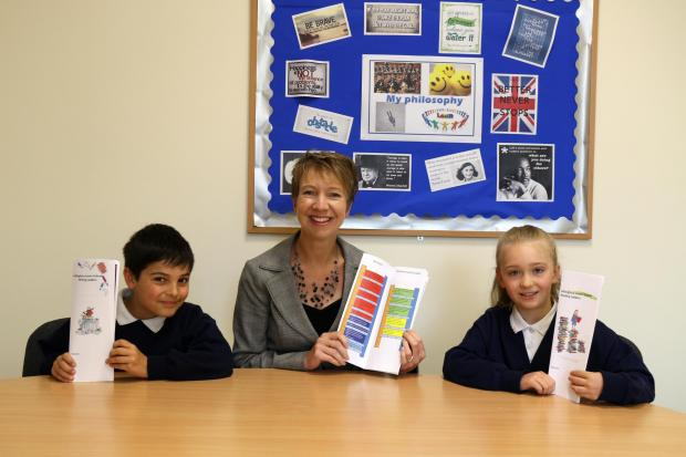 Hiltingbury Junior School  headteacher Sam Hunter with Year 4 pupils Nathan and Charlotte