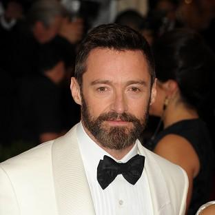 Hugh Jackman urged his fans to protect themselves against skin cancer