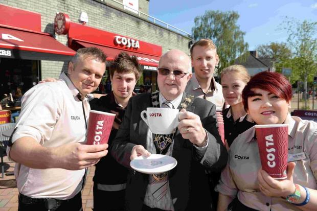 The Mayor of Eastleigh, Councillor Malcolm Cross with employees at the new Costa Coffee in Chandler's Ford.