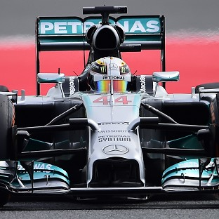 Hamilton claims pole in Barcelona