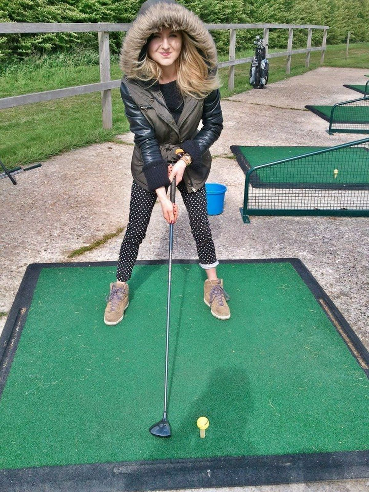 Lydia gives it some welly on the golf course.