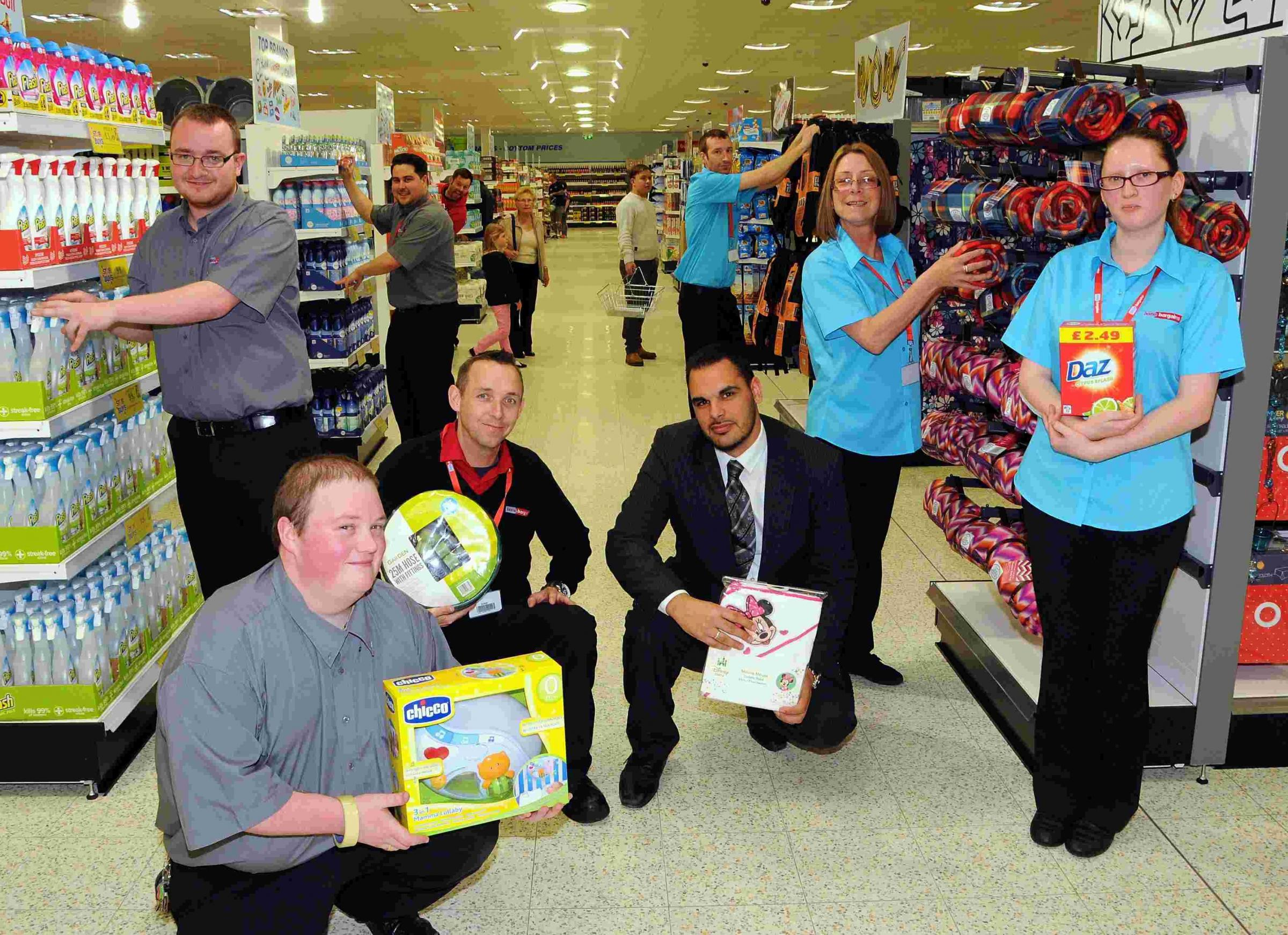 Store supervisors John Wellock and Robby Keating with area manager Kareem Jalwani and other members of staff at Home Bargains