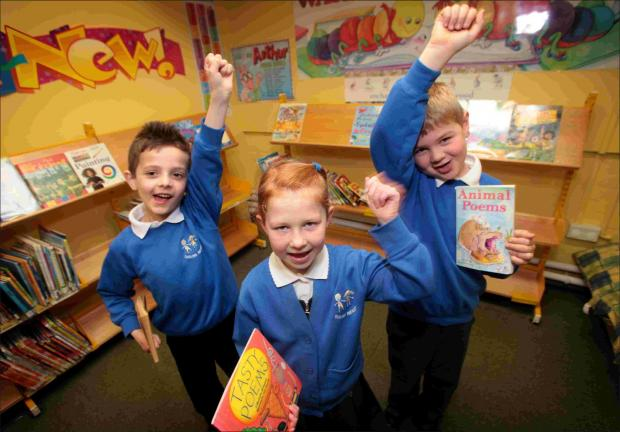 Sholing Infant School Year 1 pupils Nathan Goddard, Taya Saunders and Arthur Juggins celebrate being one of the top Shop for Schools