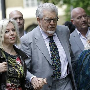 Hampshire Chronicle: Rolf Harris arrives with his family at Southwark Crown Court in London (AP)