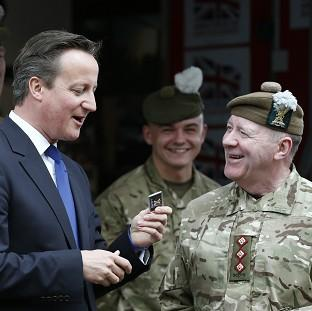 Hampshire Chronicle: Prime Minister David Cameron met with members of the Armed Forces during his visit to Glasgow on Thursday