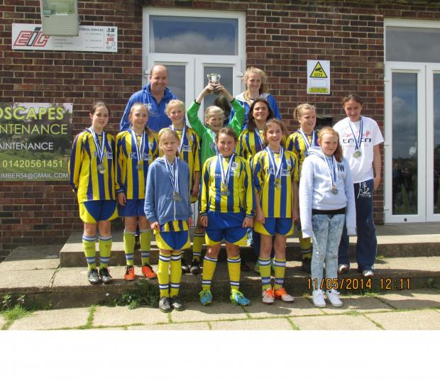 Hampshire Chronicle: CHAMPS: Romsey Town Youth girls under-12s celebrate their penalty shoot-out cup final win over Gosport .