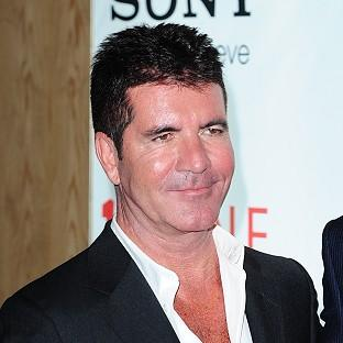 Simon Cowell reportedly bought a Salvador Dali painting at a charity auction