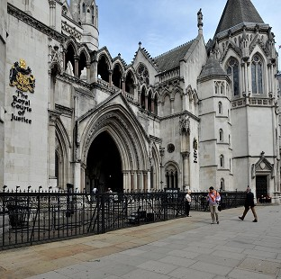 A High Court judge has raised questions over a visit made by social workers to Hungary.
