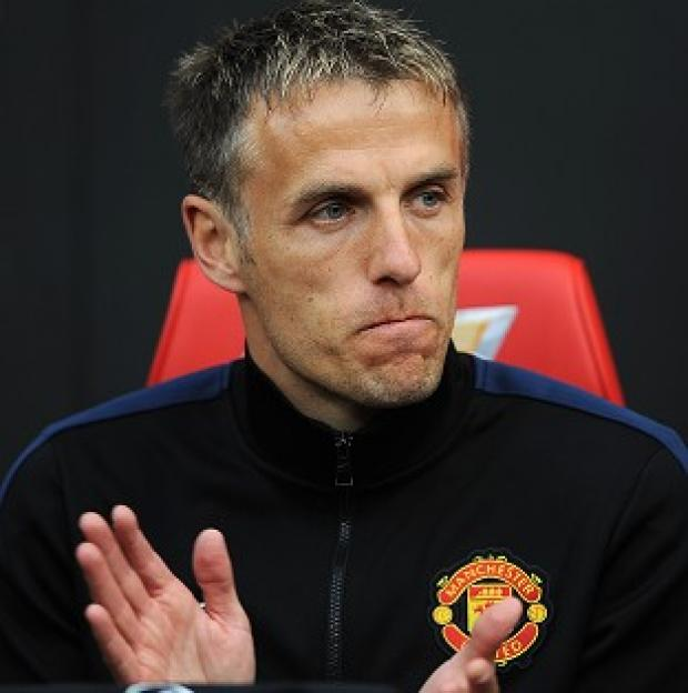 Hampshire Chronicle: Phil Neville does not yet know his future at Manchester United