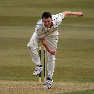 Toby Roland-Jones' 12 wickets helped Middlesex to the top of the table