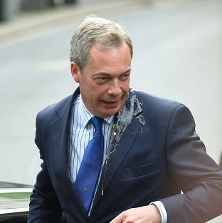 UKIP leader Nigel Farage was hit by an egg as he got out of his