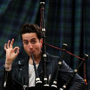 Radio 1 breakfast show host Nick Grimshaw is taught how to play the bagpipes at The