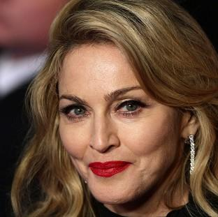 Hampshire Chronicle: Madonna could take over Kylie Minogue's revolving chair on The Voice, host Emma Willis has suggested