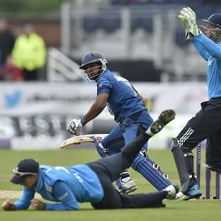 Joe Root, on the floor, and his England team-mates were handed a heavy defeat by Sri Lanka