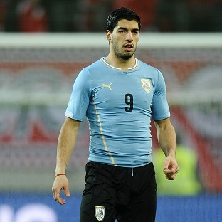 Luis Suarez had knee surgery last week and is in a race to be fit for the World Cup