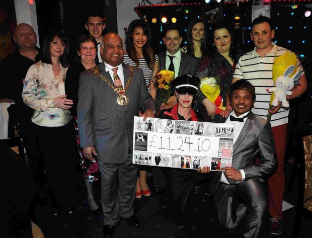 Hampshire Chronicle: The Mayor Cllr Dan Putty with entertainers, sponosrs and supporters of the Mayor's Charity Show at the Mayflower Chinese Restaurant