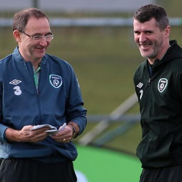 Hampshire Chronicle: Roy Keane, right, has held talks with Celtic, according to Republic of Ireland boss Martin O'Neill, left