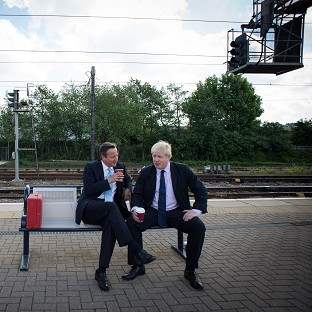 Prime Minister David Cameron and Mayor of London Boris Johnson at Newark station after a campaign visit