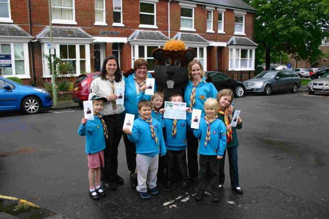 Left to right: parent helpers Sarah Bayley, Mel Hall and Sarah Evans and Susan Bowdery as Chip the beaver with members of the 6th Winchester Scout group