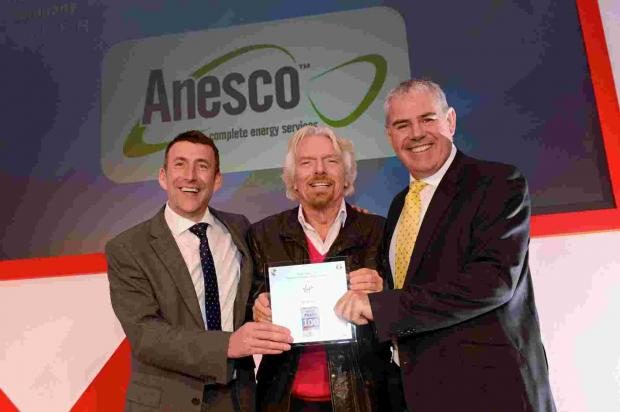 Anesco's CEO Adrian Pike, left, and COO Tim Payne, right, with Sir Richard Branson