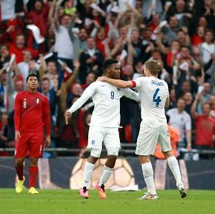 Daniel Sturridge, left, celebrates the opening goal