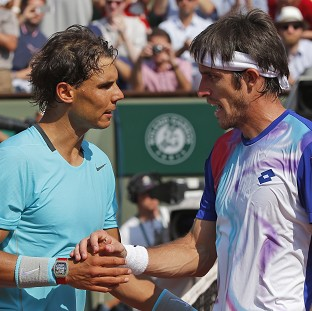 Leonardo Mayer, right, was unable to stop Rafael Nadal marching through in straight sets (AP)