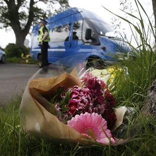 Hampshire Chronicle: Floral tributes near the scene at Little Swinton, near Coldstream, where three people were killed after a car lost control at the Jim Clark Rally in the Scottish Borders yesterday.