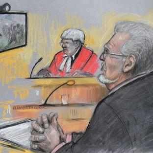 Hampshire Chronicle: Court artist sketch of Rolf Harris being shown footage of a TV game show in which he appeared during the 1970s