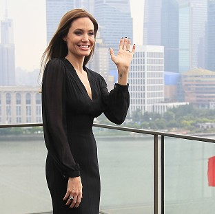 Angelina Jolie, who is promoting Maleficent in China, says she won't up red carpet security after Brad Pitt's incident with a prankster last week
