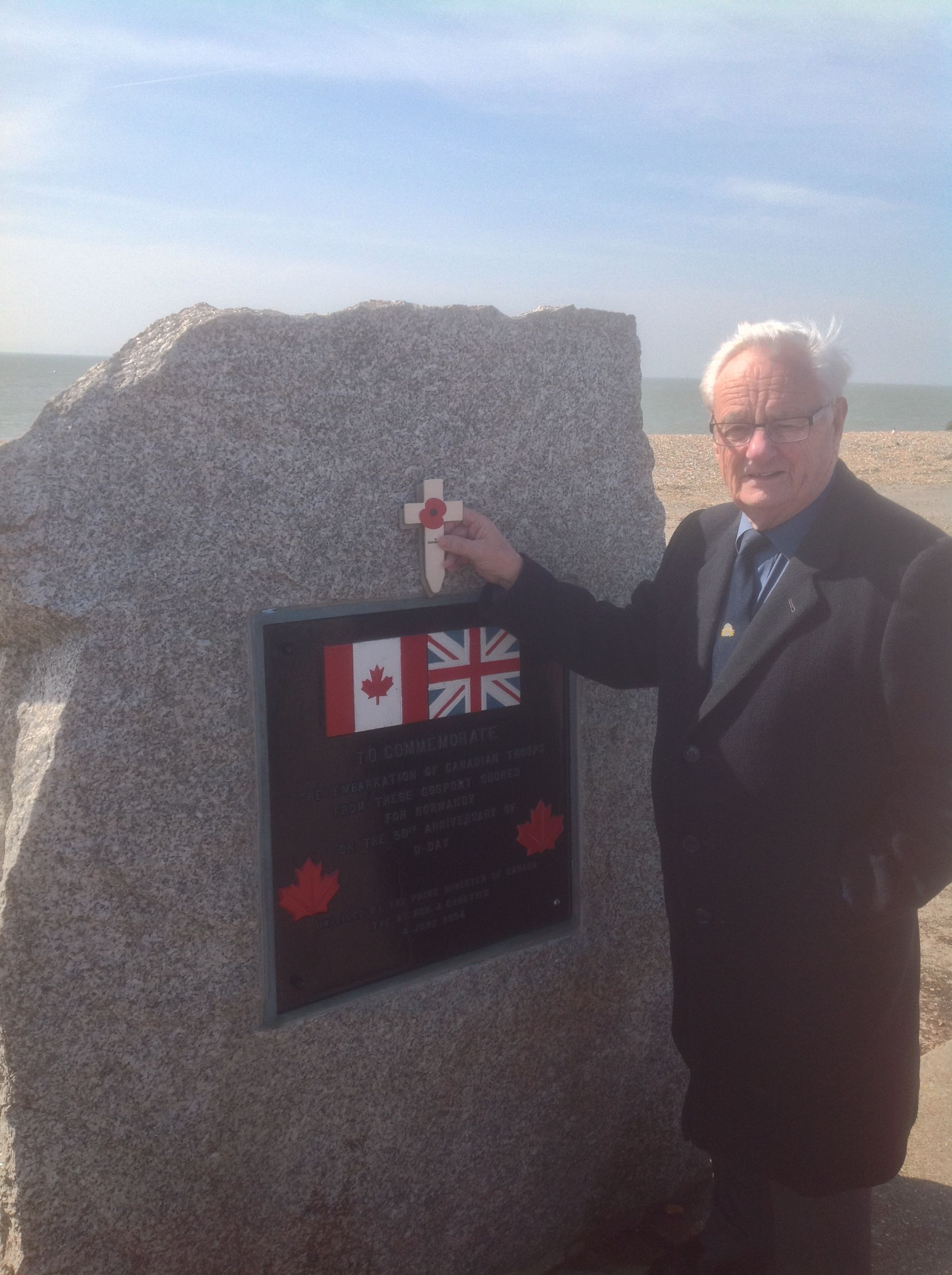 Cllr Peter Edgar visiting a D-Day memorial in Stokes Bay