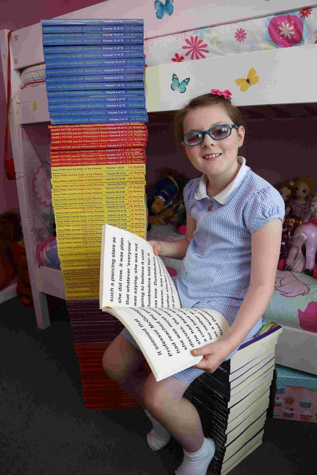 Hampshire Chronicle: Kayleigh Ann Hayes has received what is thought to be the largest copy of Harry Potter in the world.