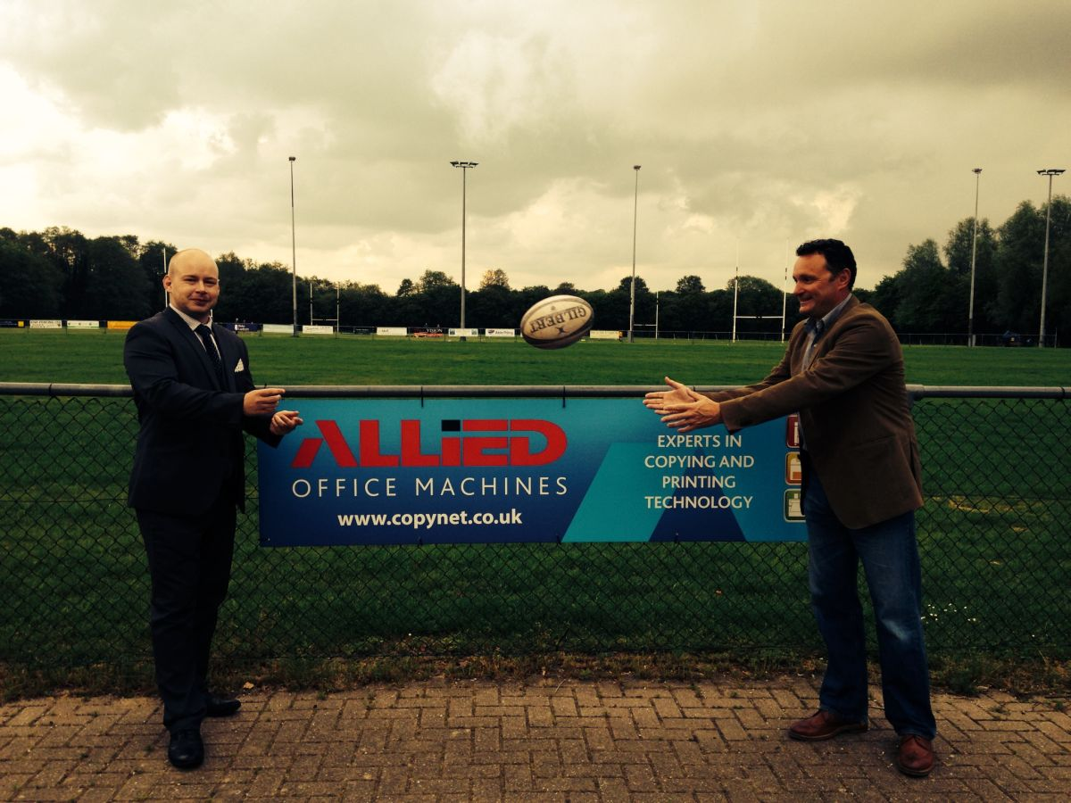 Ben Welch, WRFC sponsorship manager and senior player (left) passes to regional sales manager for Allied Office Machines, and fellow Wint