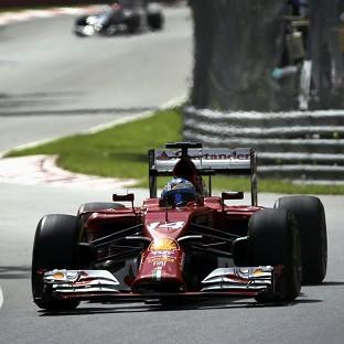 Ferrari's Fernando Alonso, pictured, topped first practice for the Canadian Grand Prix (AP)