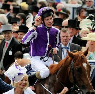 Joseph O'Brien acknowledges the crowd after his victory on Australia