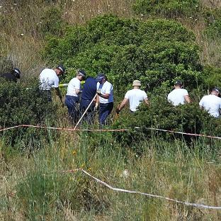Hampshire Chronicle: Police investigating the disappearance of Madeleine McCann in Portugal search a patch of scrubland