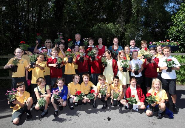 Pupils and teachers from St Francis Primary School and Knightwood Primary School join councillors to launch Valley Park in Bloom.