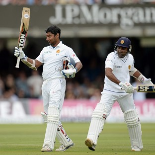Kumar Sangakkara, left, celebrates scoring his first century at Lord's