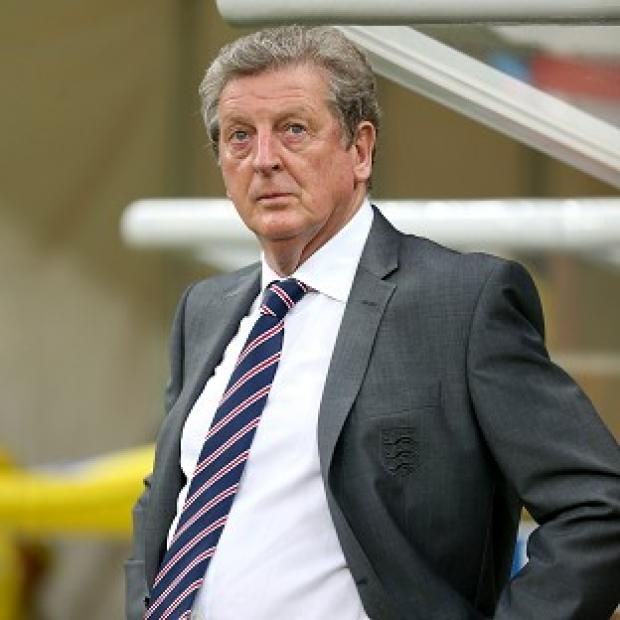 Hampshire Chronicle: England manager Roy Hodgson has sprung to the defence of Wayne Rooney after the 2-1 defeat to Italy