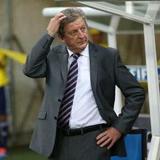 Roy Hodgson, pictured, does not think Uruguay striker Luis Suarez is world class yet