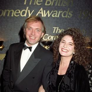 Rik Mayall's wife Barbara has asked fans to remember him in their prayers