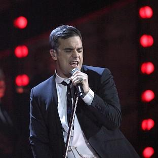 Robbie Williams is struggling through his latest tour with a bad back