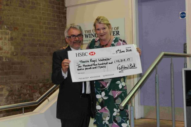 Catherine Skinner presenting cheque to Mark Courtice