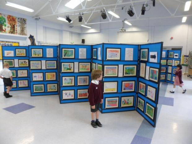 The children's work was professionally framed and displayed by a local art ex