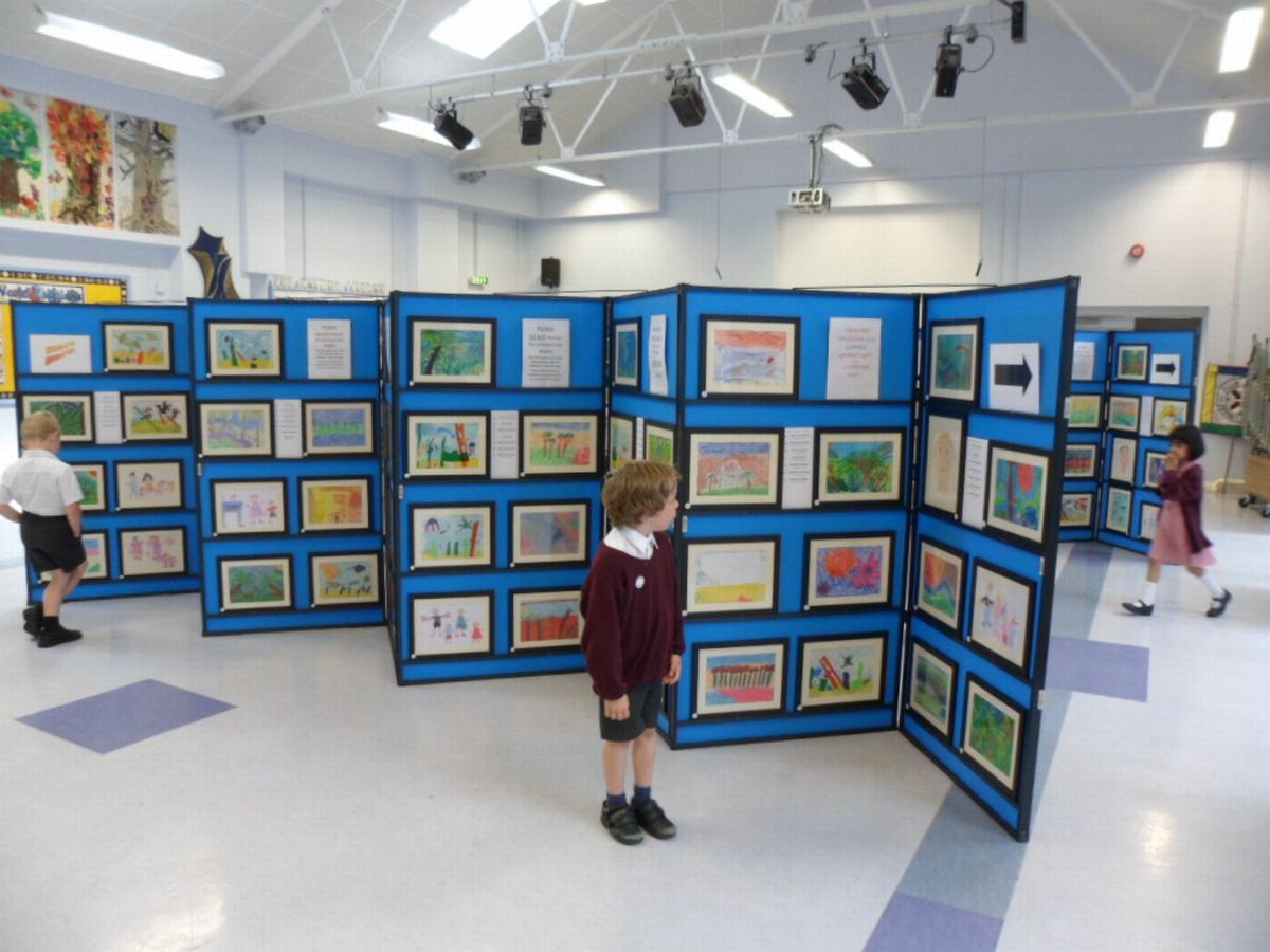 The children's work was professionally framed and displayed by a local