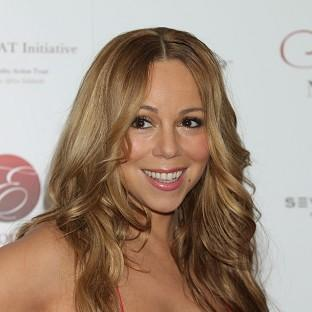 Mariah Carey has asked fans to send ideas for her artwork