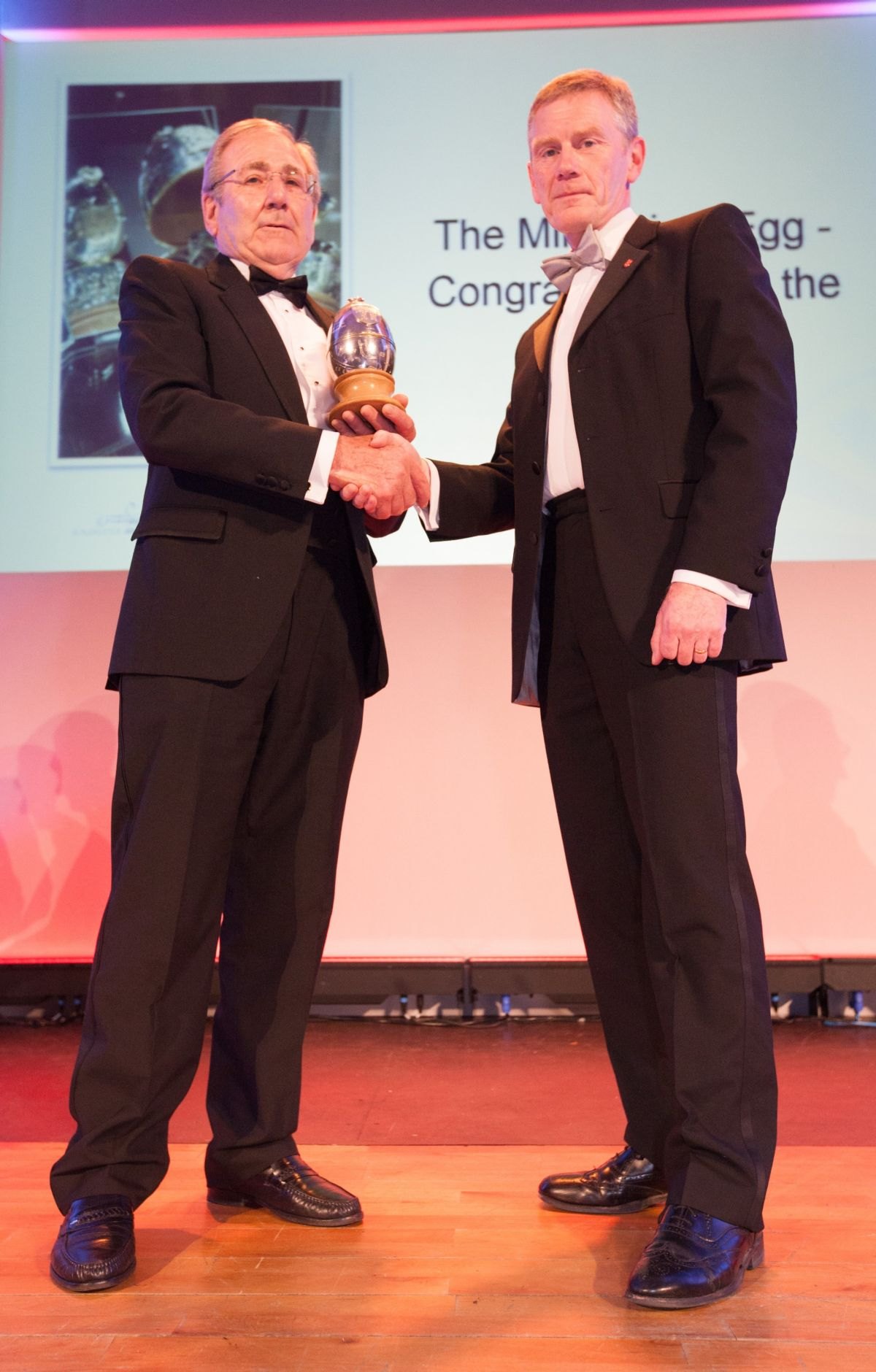 Charles Barter receiving the award from Simon Eden, city council chief executive